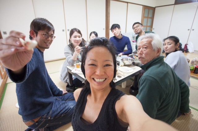 Japanese people group selfie at meal