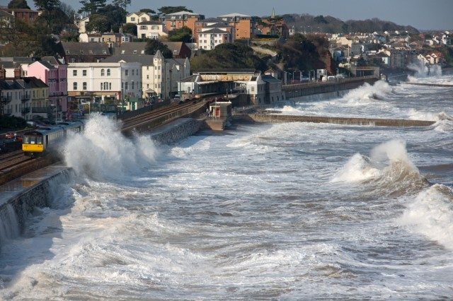Train leaving Dawlish station in a storm