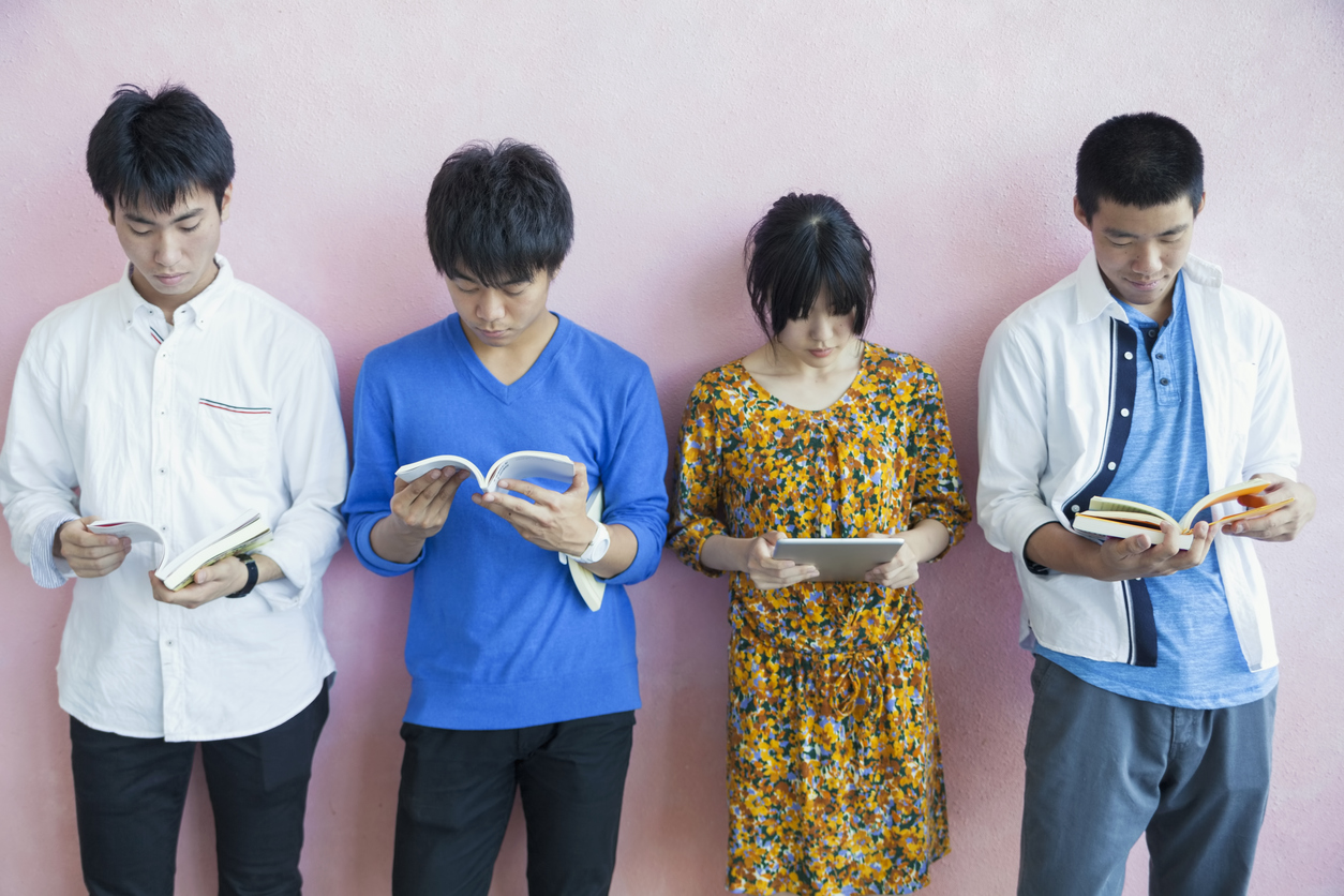 Students Lean Against Pink Wall