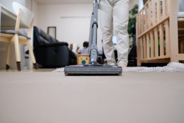 housewife vacuuming room