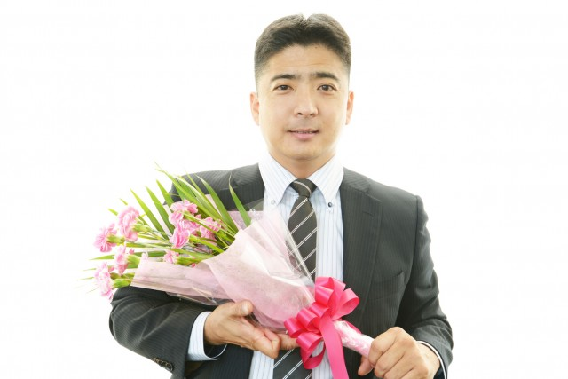 Man holding flower bouquet