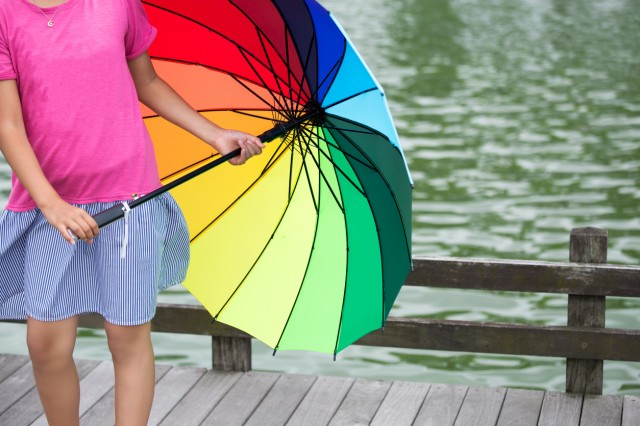 A girl with multi colored umbrella