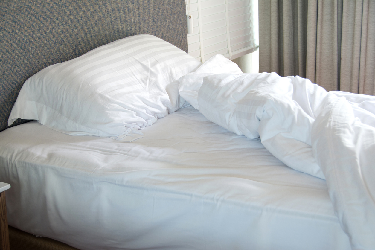 white bedding sheets and pillow