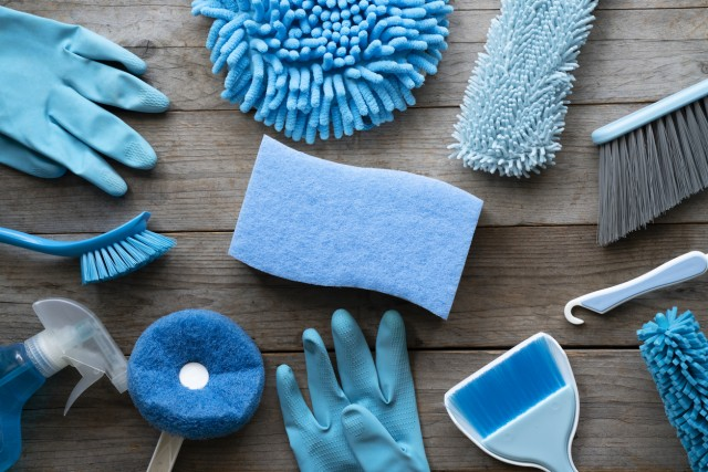 House cleaning product on wood table, blue equipment concept