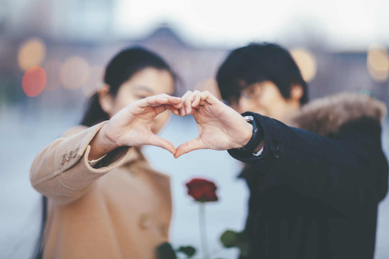 Couple Making Heart Shape With Their Hands