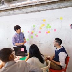 Businessman giving presentation in modern co-working space